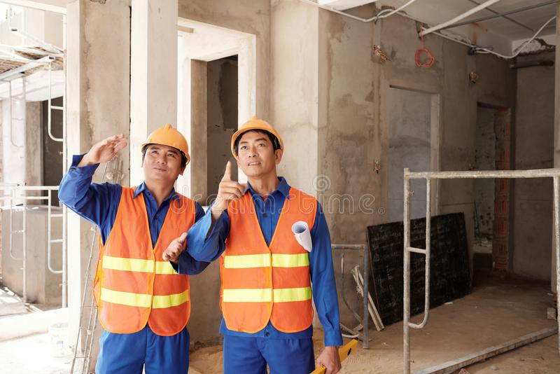 Contractors discussing progress of work stock photography