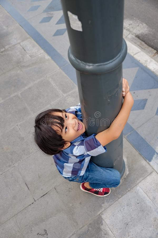 Cheerful Asian Child Having Fun on Sidewallk royalty free stock photography