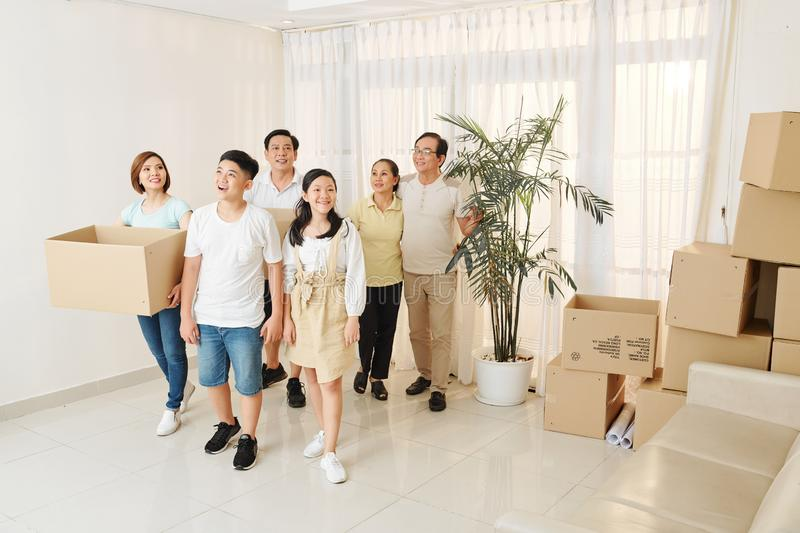 Family entering new house stock photography