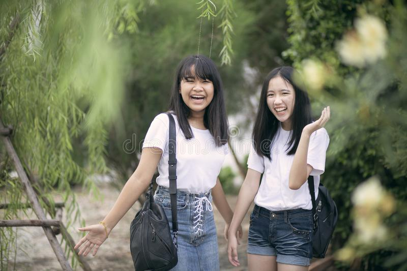 Cheerful asian teenager laughing in green park stock images