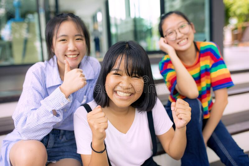 Cheerful asian teenager at school bulding royalty free stock images