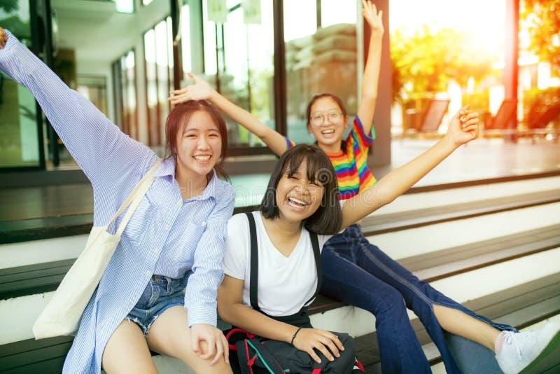 Cheerful asian teenager at school bulding royalty free stock photo