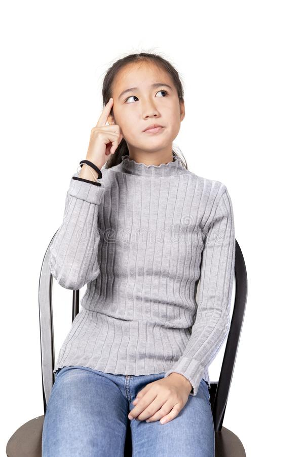 Cheerful asian teenager wisdom thinking royalty free stock photo