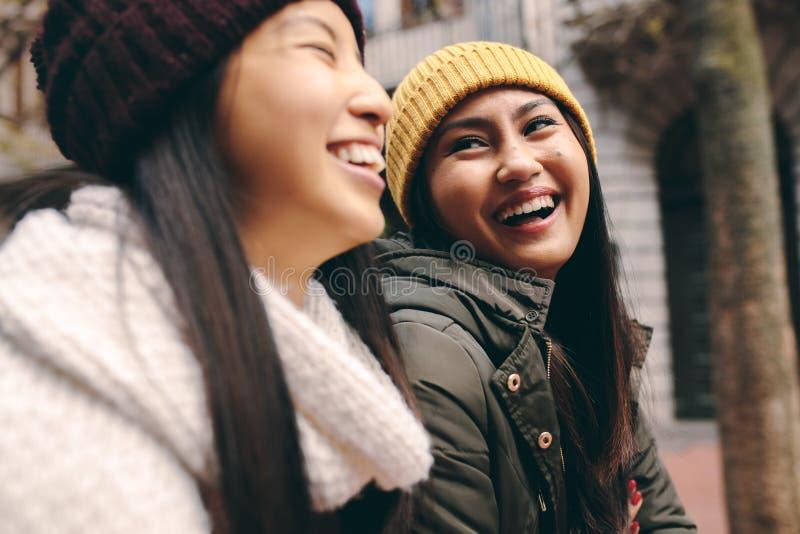 Cheerful asian women walking on street royalty free stock photography