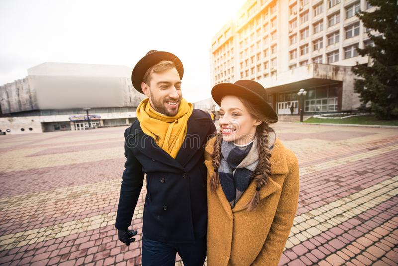 cheerful attractive young couple walking royalty free stock images