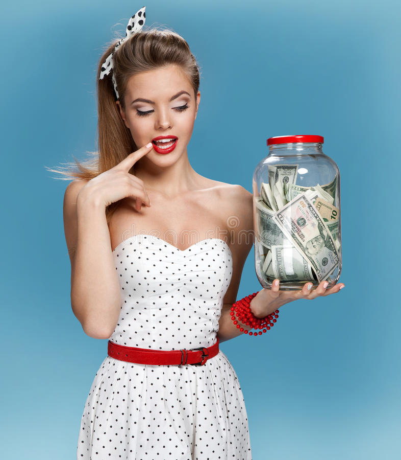 Cheerful attractive young lady holding cash and happy smiling. Shopping concept stock photography