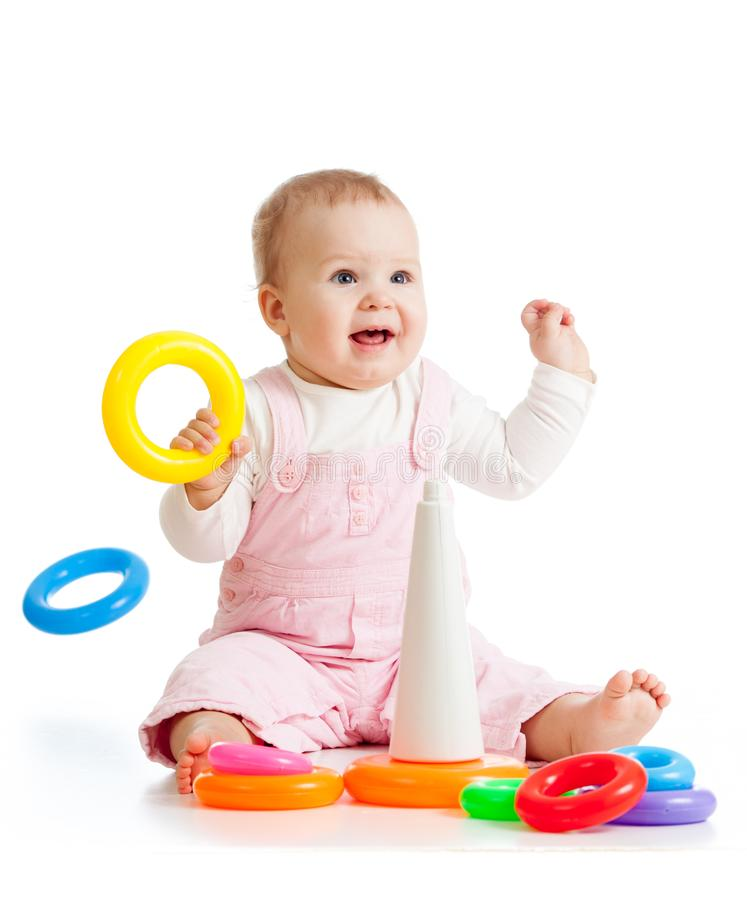 Cheerful baby playing with pyramid toy royalty free stock photos
