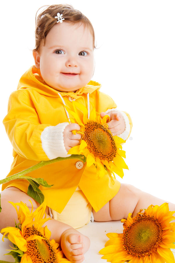 Cheerful baby among sunflowers royalty free stock photos