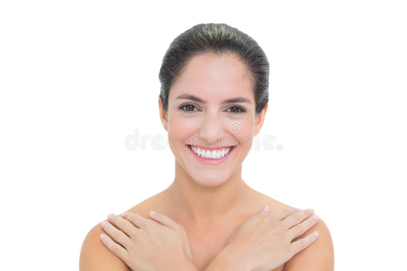 Cheerful Bare Brunette Touching Both Shoulders Royalty Free Stock Images