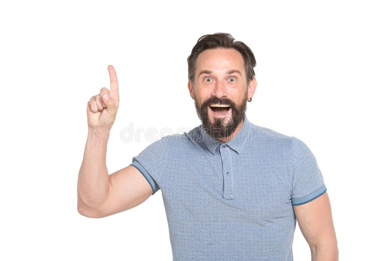 Cheerful bearded man keeping his finger up with excitement stock photos