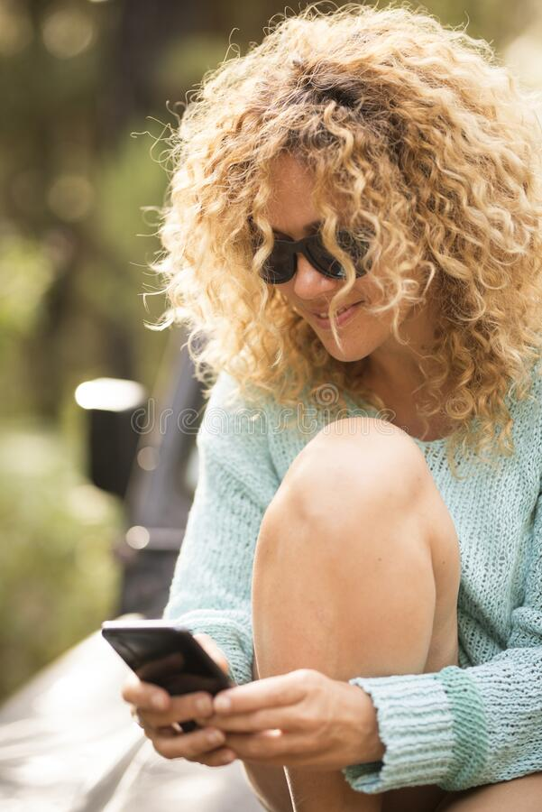 Free Cheerful Beautiful Adult Caucasian Woman Enojy The Phone Connection In Outdoor Leisure Activity Alone - People And Modern Stock Photo - 189077030