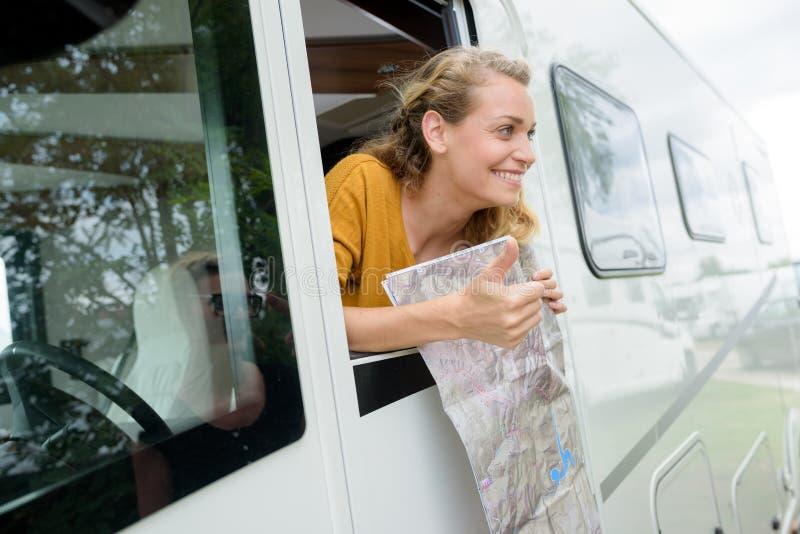 Cheerful beautiful woman minivan royalty free stock image