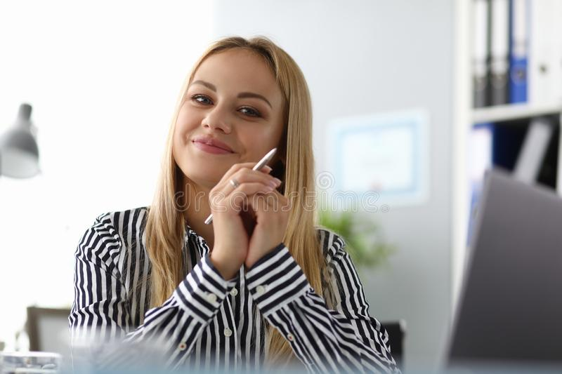 Cheerful beautiful woman posing in office stock images