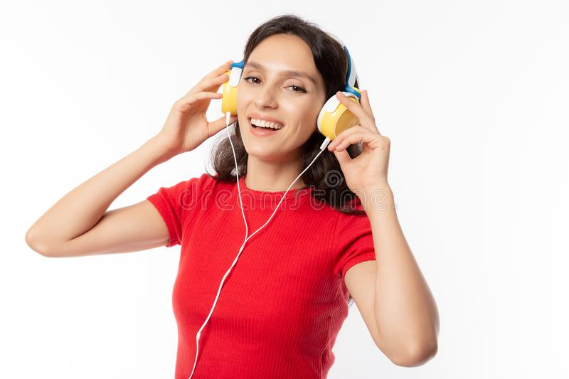 Cheerful beautiful young lady listening music by using headphone with smiley face, happiness when pretty girl listen nice music ma stock photos
