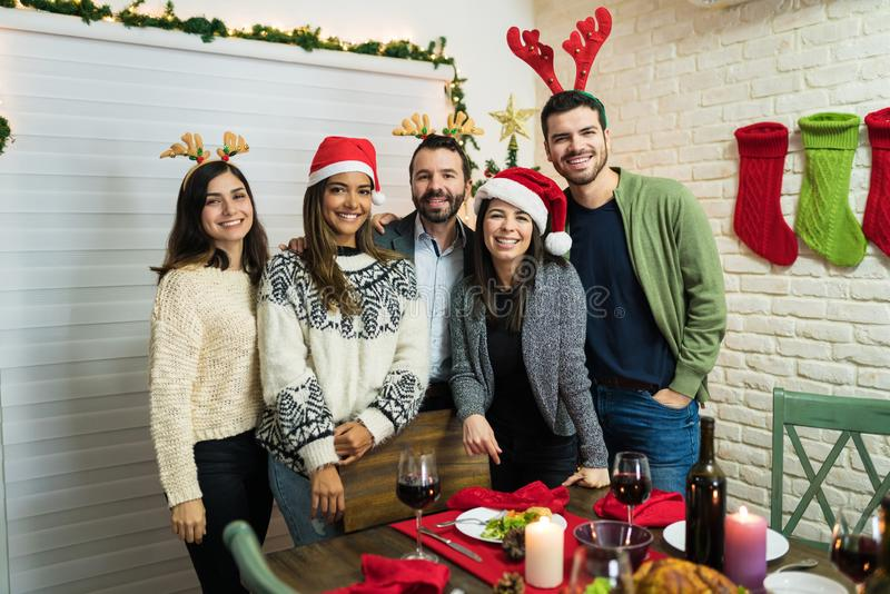 Cheerful Best Friends Celebrating Christmas Together At Home stock photography