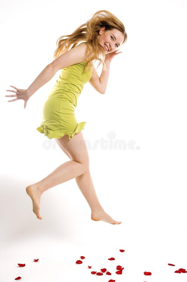 The cheerful blonde jumps stock photo
