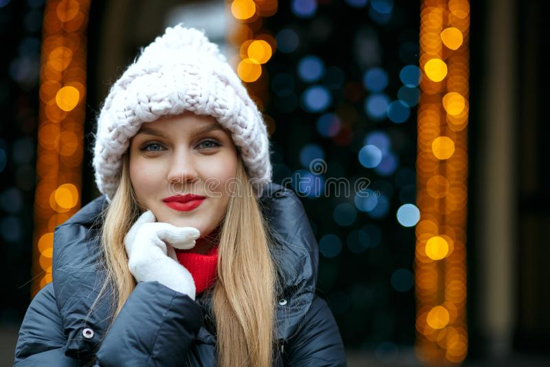 Cheerful blonde woman with red lips enjoying winter holidays at stock photography
