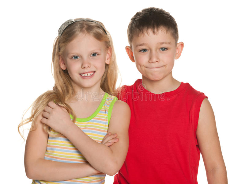 Cheerful boy and girl are standing together. On the white background stock image