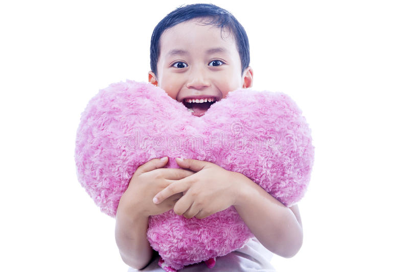 Cheerful Boy Holding Heart Pillow Royalty Free Stock Photos