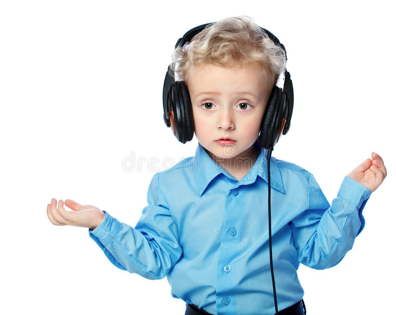 Download Cheerful Boy Listening To Music Royalty Free Stock Photo - Image: 27535745