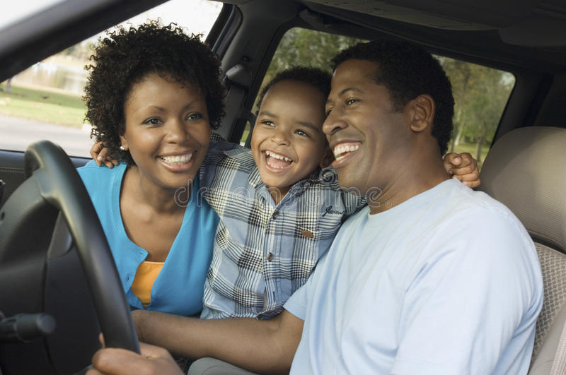 Cheerful Boy And Parents Sitting In Car royalty free stock images