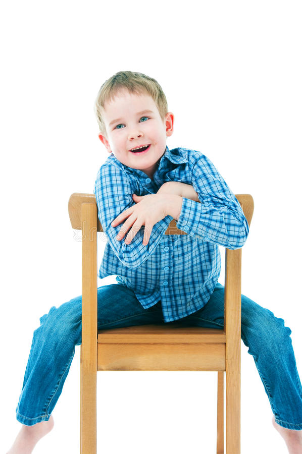 Free Cheerful Boy Sitting On A Chair Royalty Free Stock Images - 26138229
