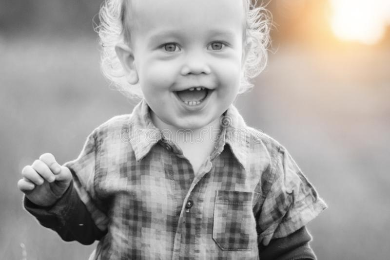 Cheerful boy smile outdoors closeup portrait. Cheerful boy in smile closeup, cute toddler laughing stock images