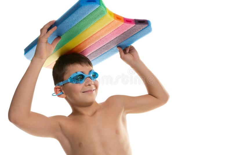 Cheerful boy swimmer in swimming glasses and with a board for swimming above his head, concept of sport and lifestyle, on a white royalty free stock images