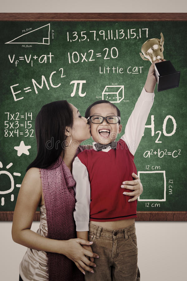 Download Cheerful Boy Wins Math Trophy Kiss By Mother Stock Photo - Image: 27642866