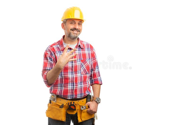 Builder showing number four with fingers royalty free stock photography