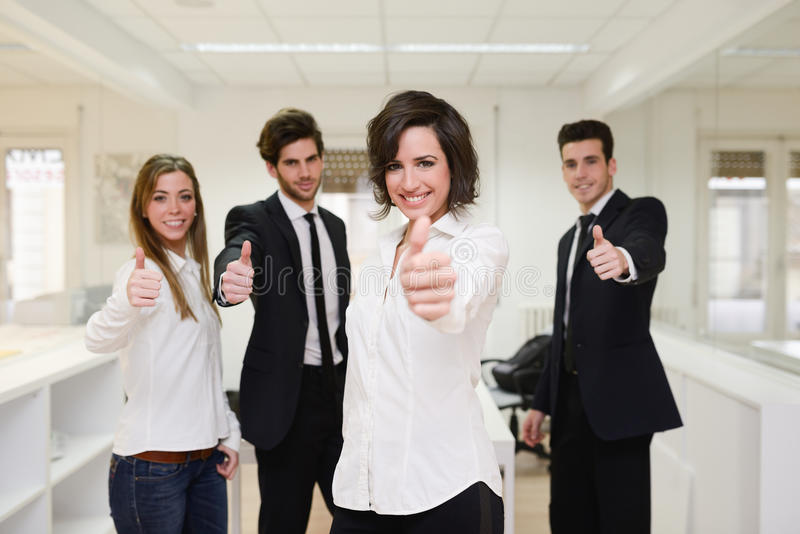 Cheerful business group giving thumbs up royalty free stock photos