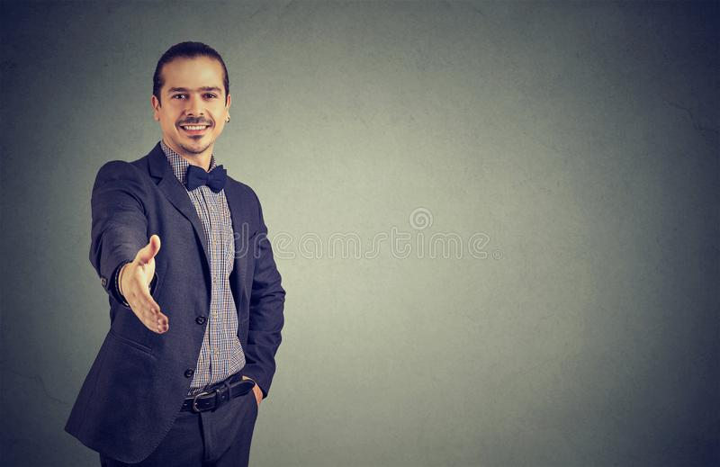 Cheerful business man giving handshake royalty free stock photography