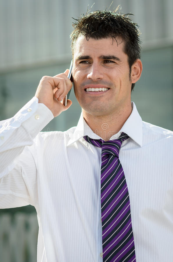 Cheerful business man with phone stock images