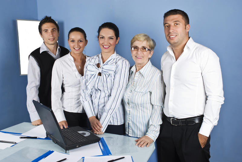 Cheerful business people group in a office royalty free stock photo