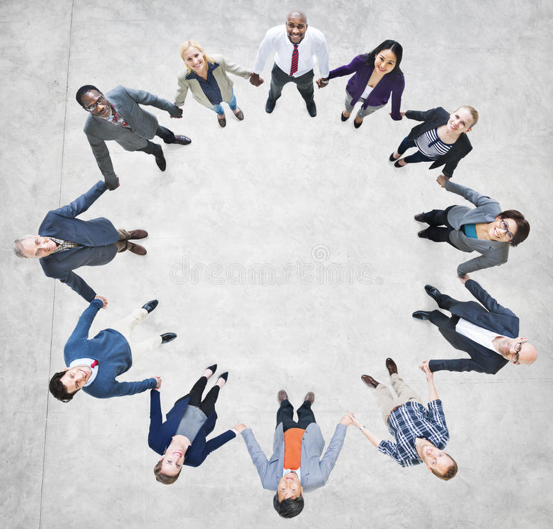 Cheerful Business People Holding Hands Forming a Circle.  royalty free stock images