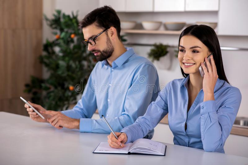 Cheerful business people sitting in the kitchen stock photo
