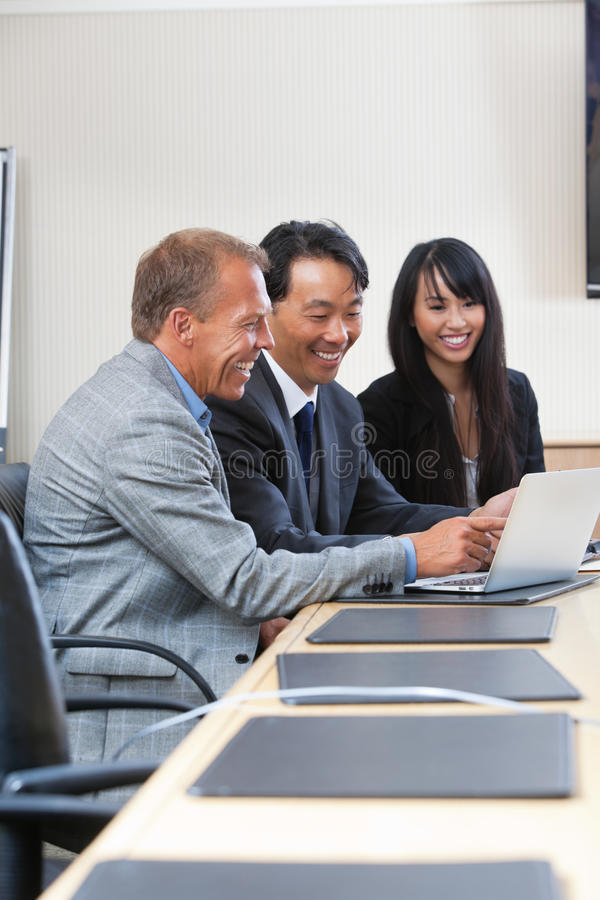 Cheerful business people at work stock photo