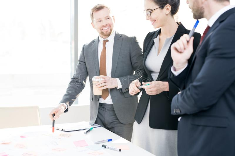 Cheerful Business Team Collaborating royalty free stock image