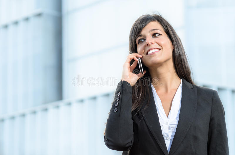 Cheerful business woman with phone royalty free stock image