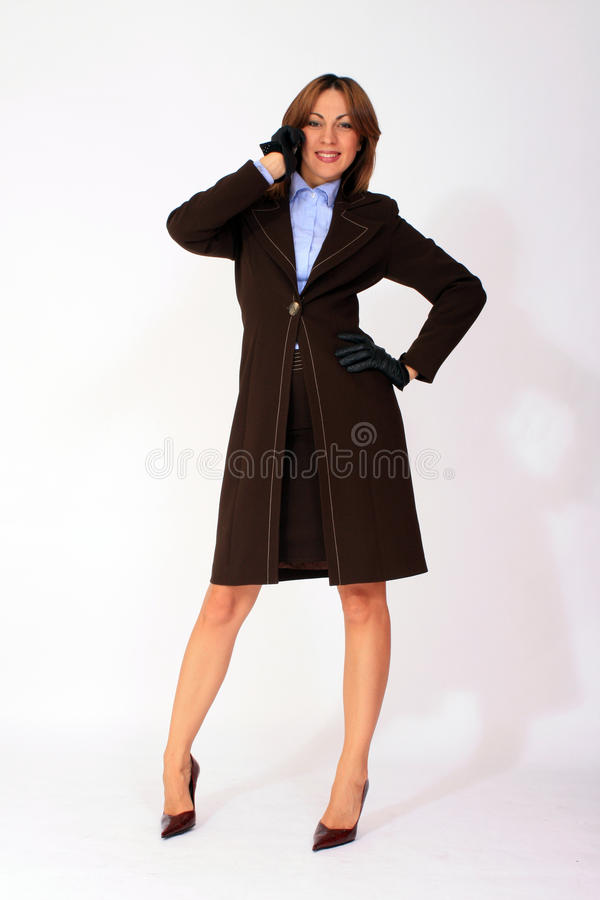 Cheerful business woman talking on the phone royalty free stock images