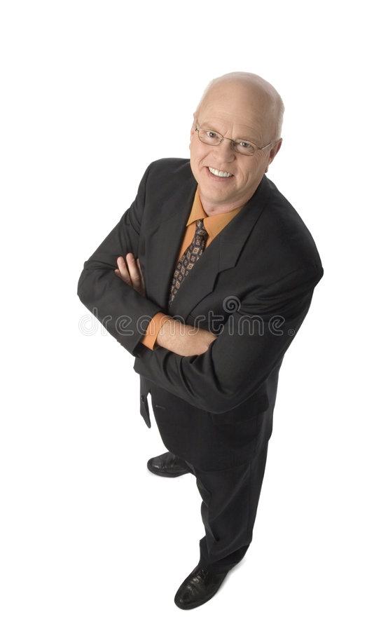 Cheerful businessman. Standing with arms crossed royalty free stock photography