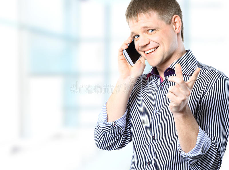Cheerful businessman in bright office looking at camera royalty free stock photo