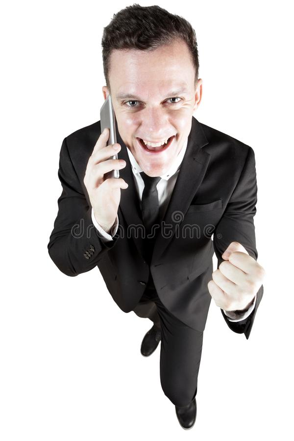 Cheerful businessman listening good news stock photo