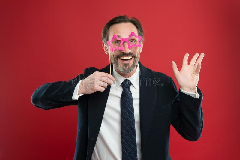 Cheerful businessman in party photo booth props. Guy enjoying party carnival. Holiday party celebration. Having fun. Office party corporate. Join carnival. Man royalty free stock images