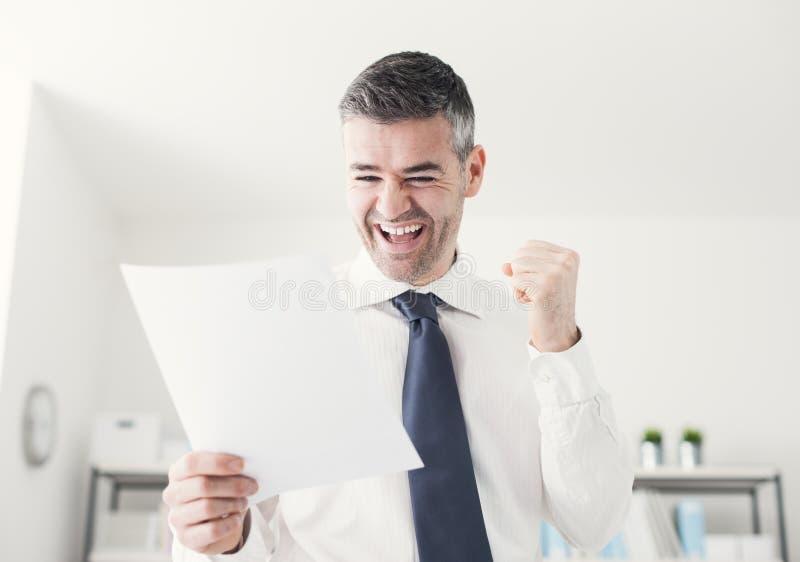 Cheerful businessman receiving good news royalty free stock photo