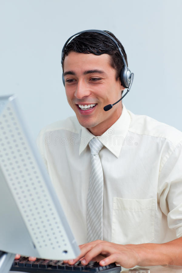 Cheerful businessman using headset stock images