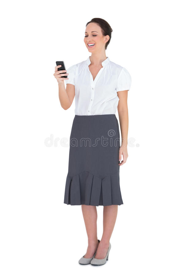 Download Cheerful Businesswoman Holding Her Phone Stock Photo - Image: 33030438