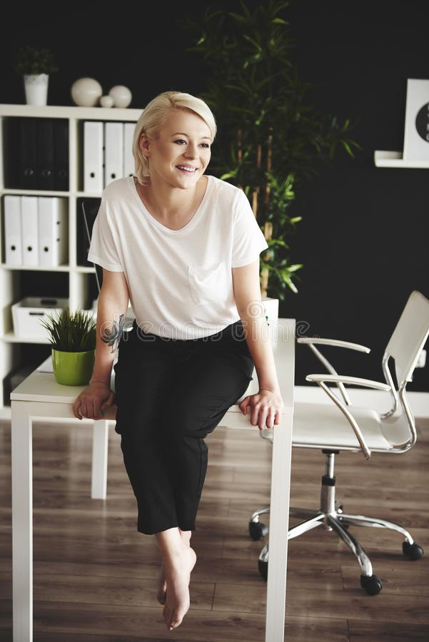 Blonde business woman in the office royalty free stock image