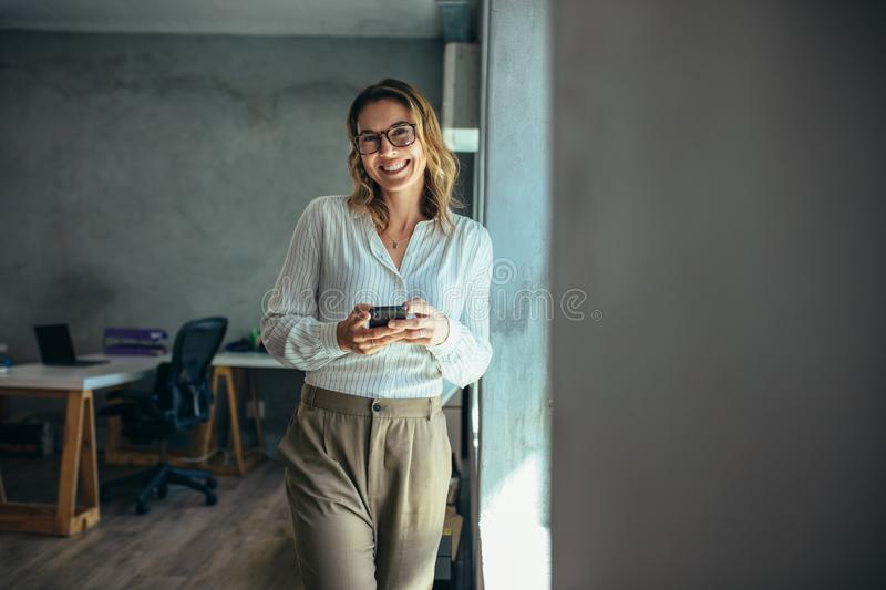 Cheerful businesswoman in office royalty free stock images