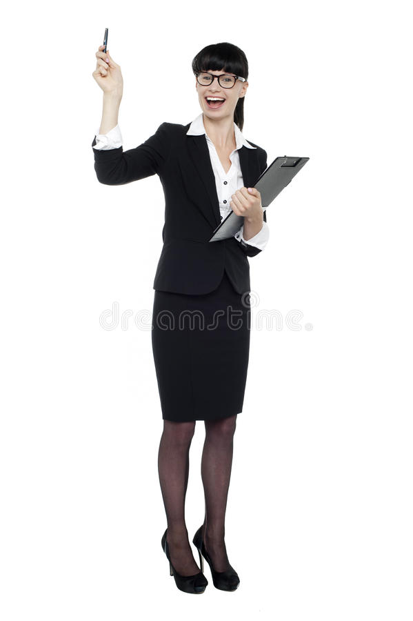 Download Cheerful Businesswoman Posing With Raised Arm Royalty Free Stock Images - Image: 27589529